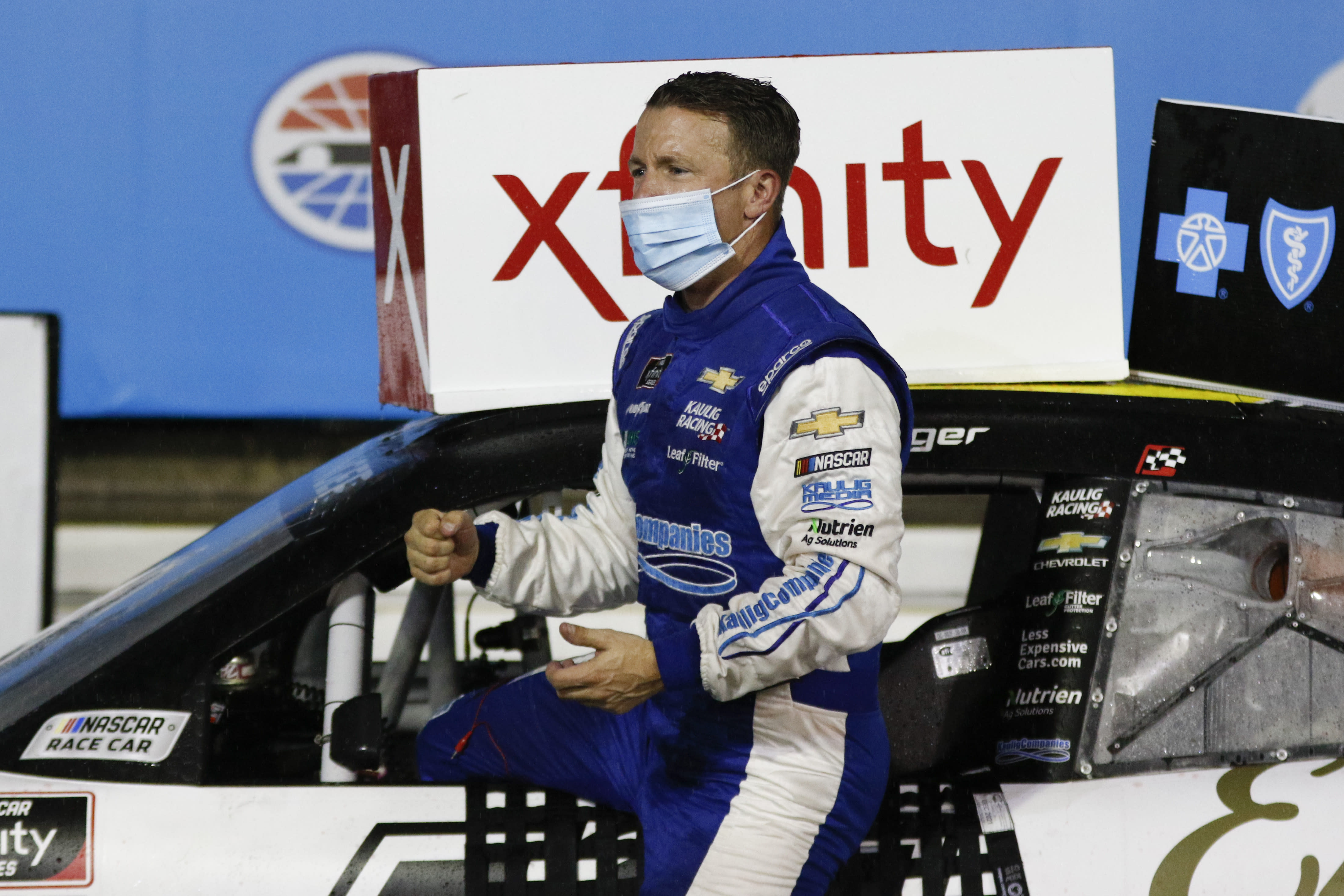 AJ Allmendinger climbs out of his car in Victory Lane after winning a NASCAR Xfinity Series auto race at Charlotte Motor Speedway in Concord, N.C., Saturday, Oct. 10, 2020. (AP Photo/Nell Redmond)