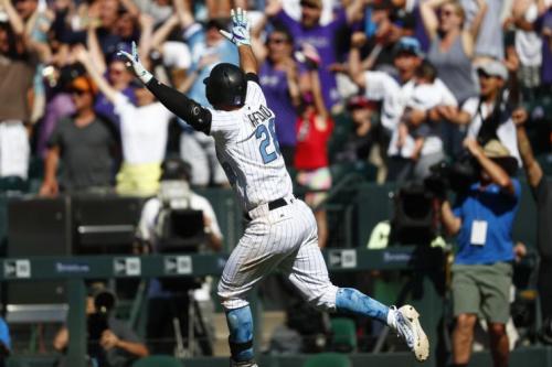 Nolan Arenado deserved to celebrate after Sunday's performance. (AP Photo)