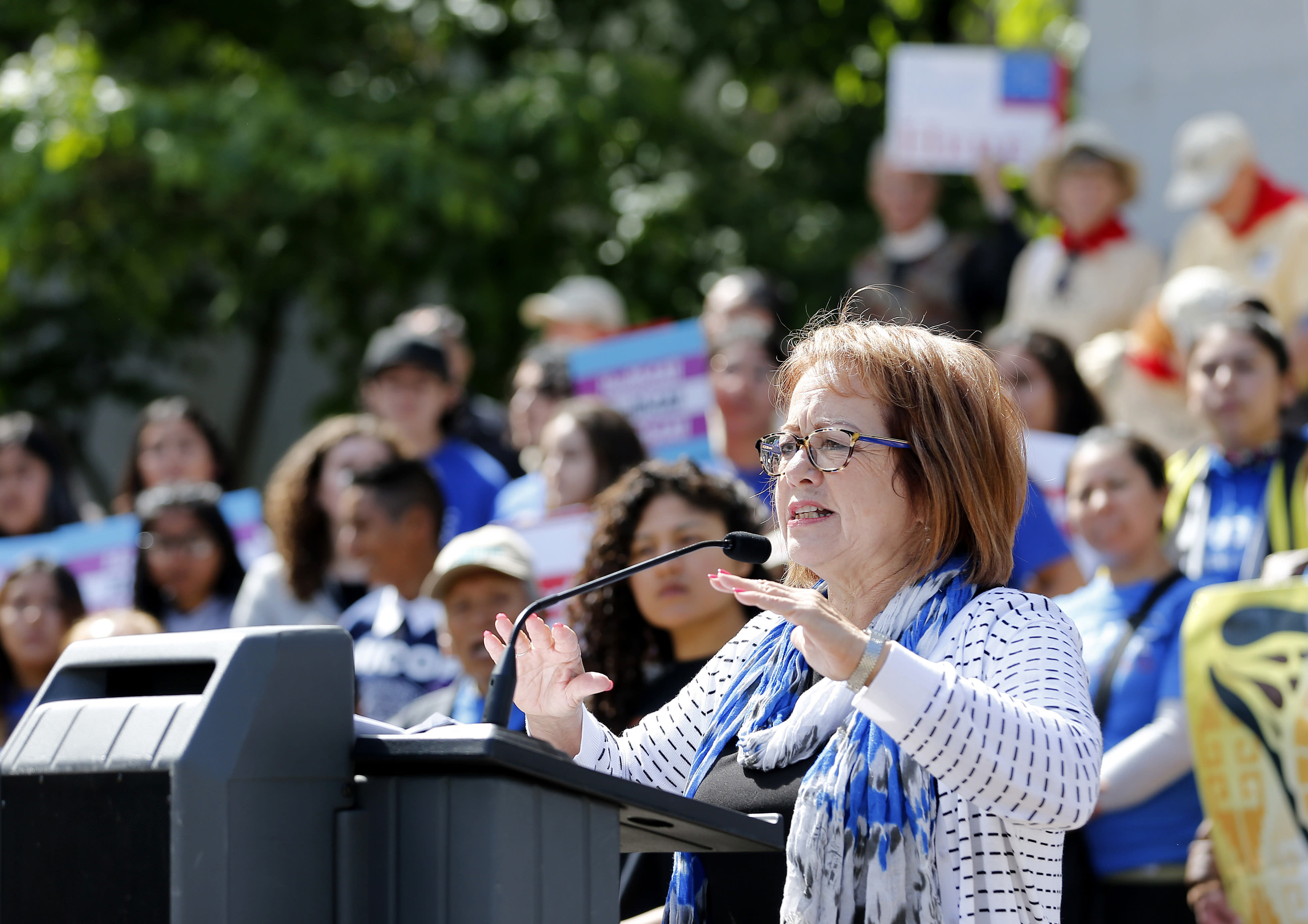 State Sen. Maria Elena Durazo, D-Los Angeles, addresses a gathering at the Immigrants Day of Action rally, Monday, May 20, 2019, in Sacramento, Calif. Gov. Gavin Newsom has proposed offering government-funded health care benefits to immigrant adults ages 19 to 25 who are living in the country illegally. Durazo, has proposed a bill to expand that further to include seniors age 65 and older. (AP Photo/Rich Pedroncelli)