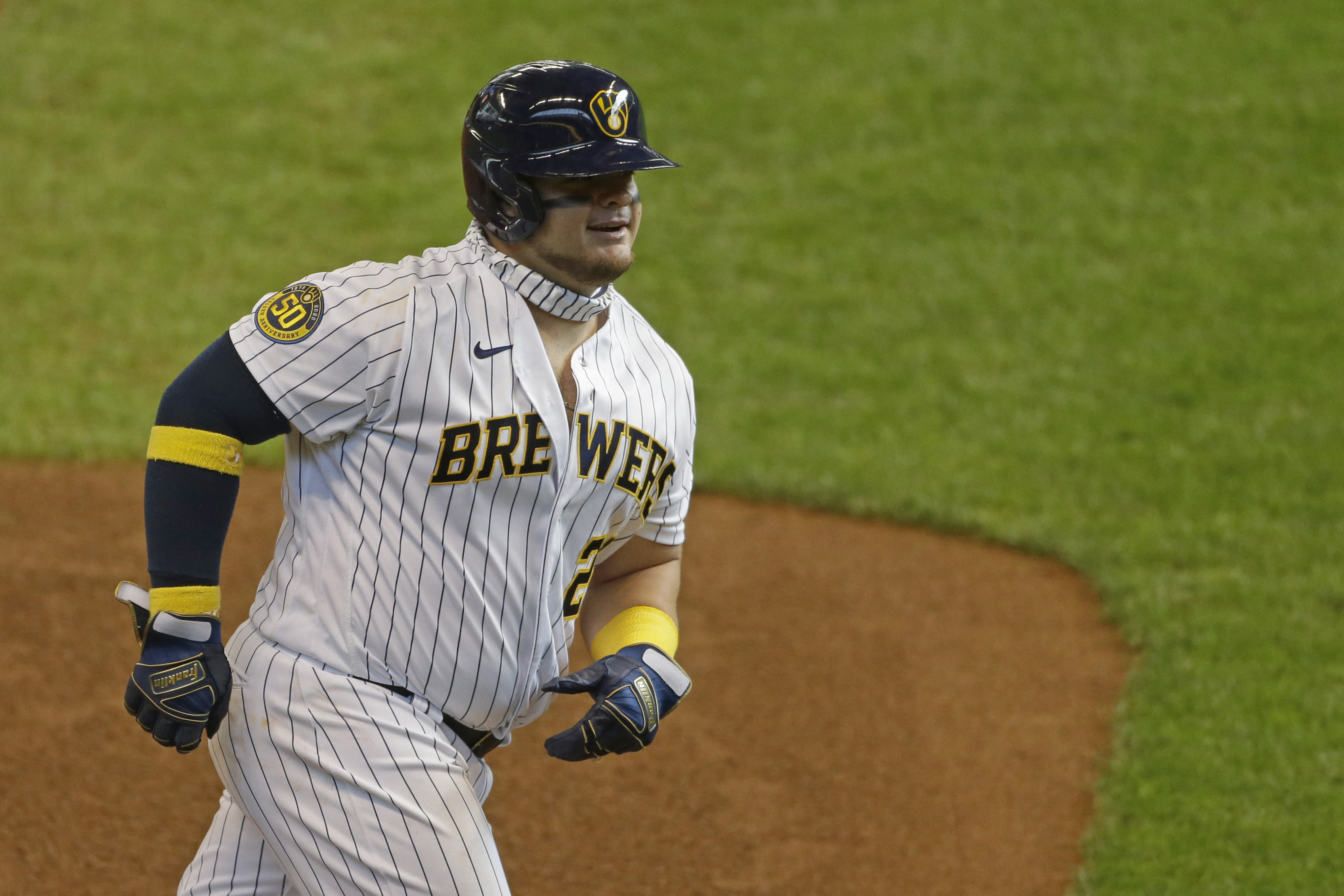 Milwaukee Brewers' Daniel Vogelbach smiles as he rounds third base after hitting a three-run home run during the sixth inning of a baseball game against the Kansas City Royals Sunday, Sept. 20, 2020, in Milwaukee. (AP Photo/Aaron Gash)