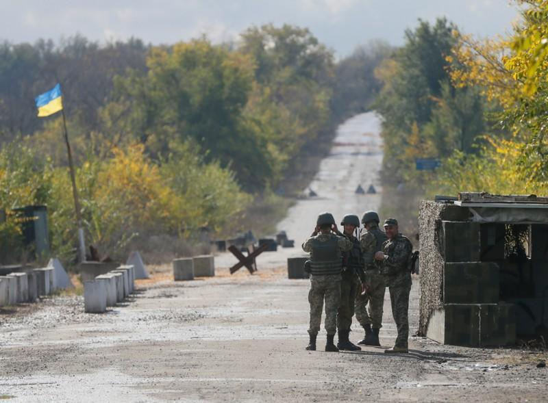 Army, rebels withdraw in Ukraine's east