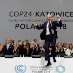 Nations overcome last-minute divisions to forge climate deal
