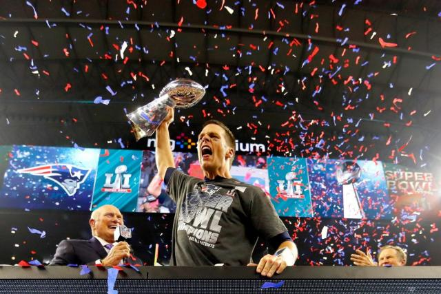 Tom Brady celebrates his record-tying fifth Super Bowl victory. (Getty Images)
