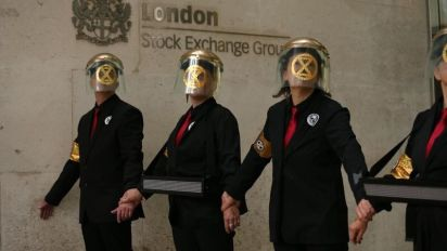 Environmental protesters glue themselves to the London Stock Exchange