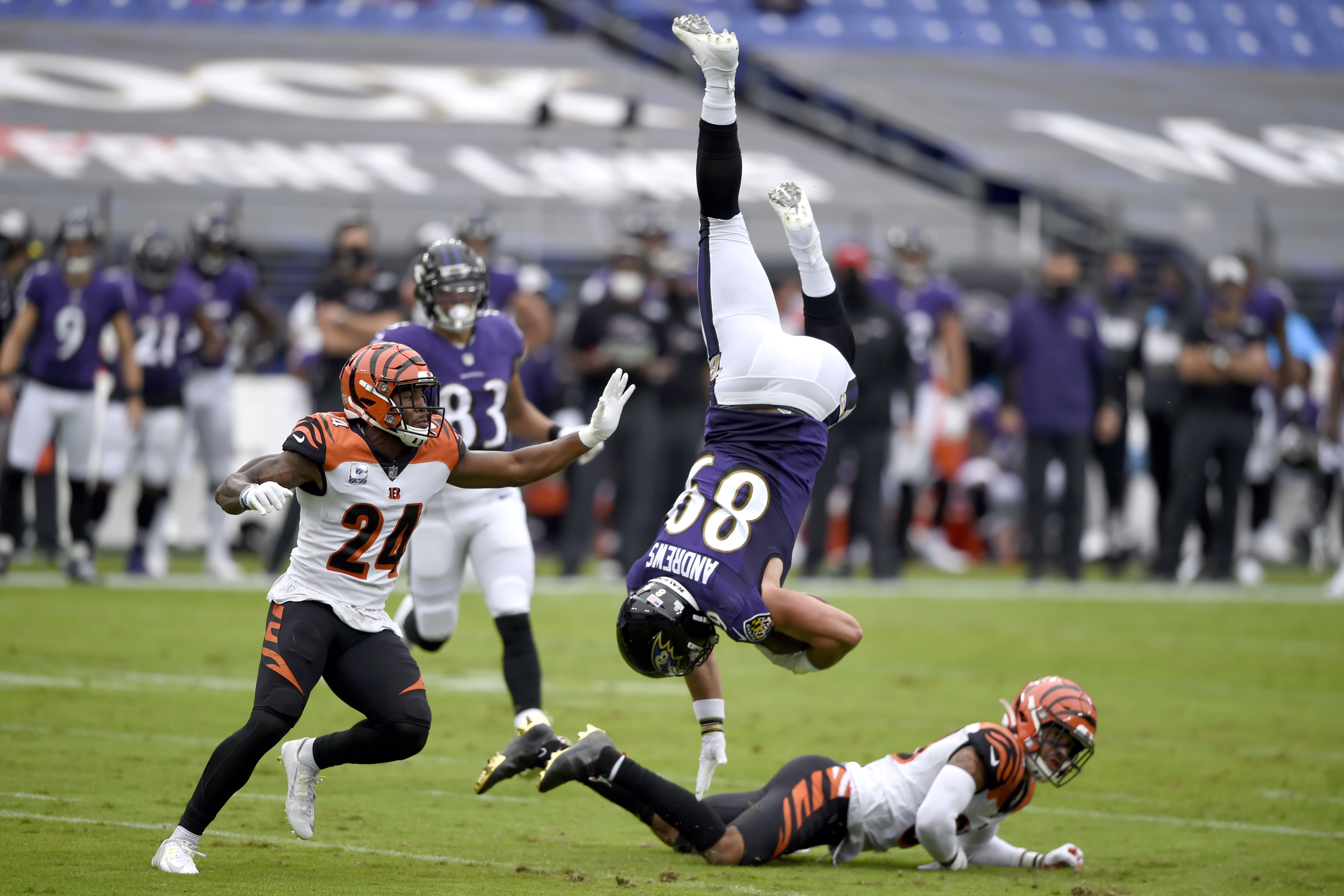 Baltimore Ravens tight end Mark Andrews (89) is upended by Cincinnati Bengals free safety Jessie Bates, right, after making a catch during the first half of an NFL football game, Sunday, Oct. 11, 2020, in Baltimore. (AP Photo/Gail Burton)