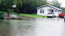Flood Waters Rise Outside Texas Home in Weslaco