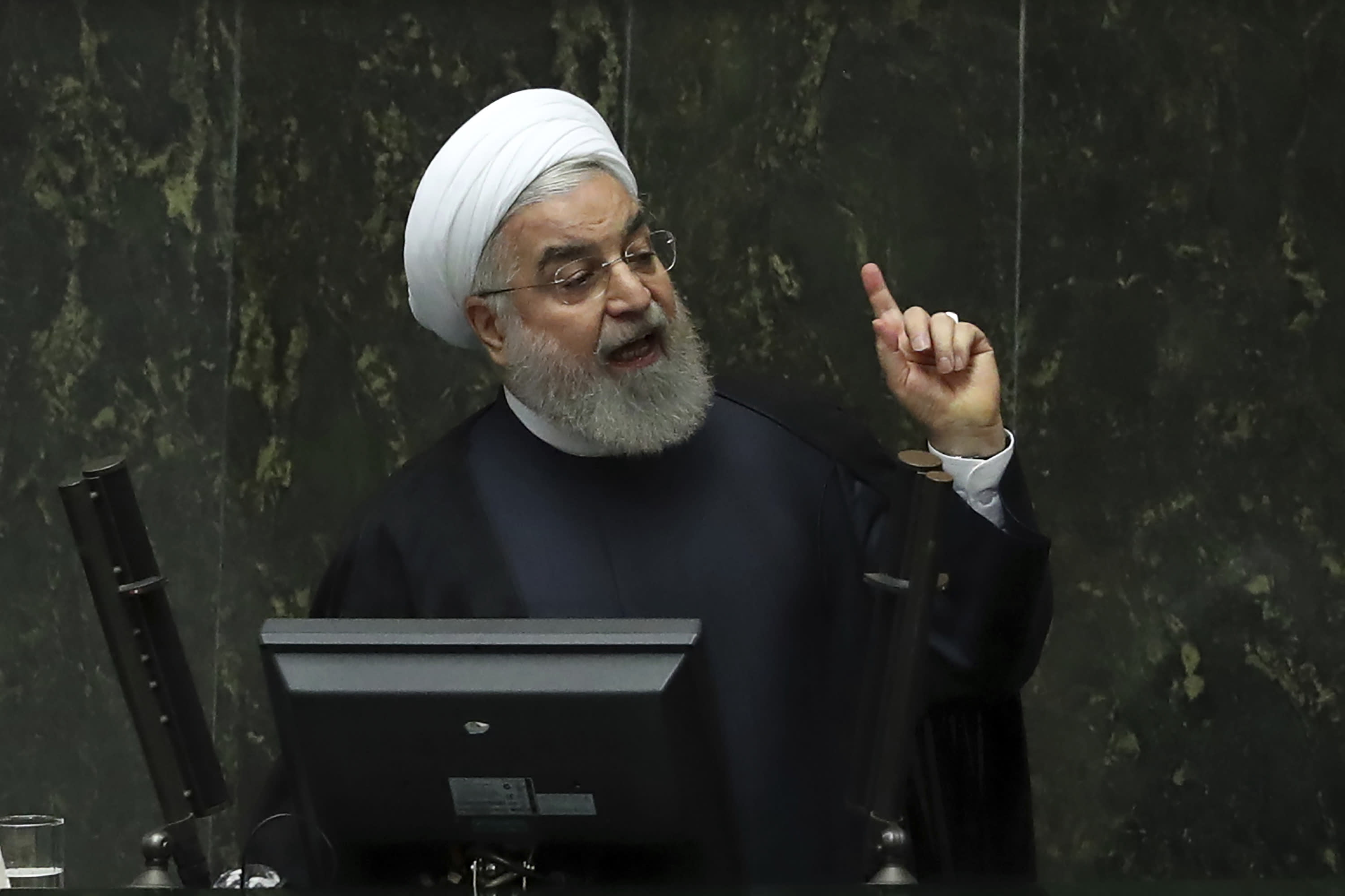 Iranian President Hassan Rouhani speaks at a session of parliament to debate his proposed tourism and education ministers, in Tehran, Iran, Tuesday, Sept. 3, 2019. Rouhani said European nations are failing to implement their commitments following the U.S. pullout from the 2015 nuclear deal with Tehran. (AP Photo/Vahid Salemi)
