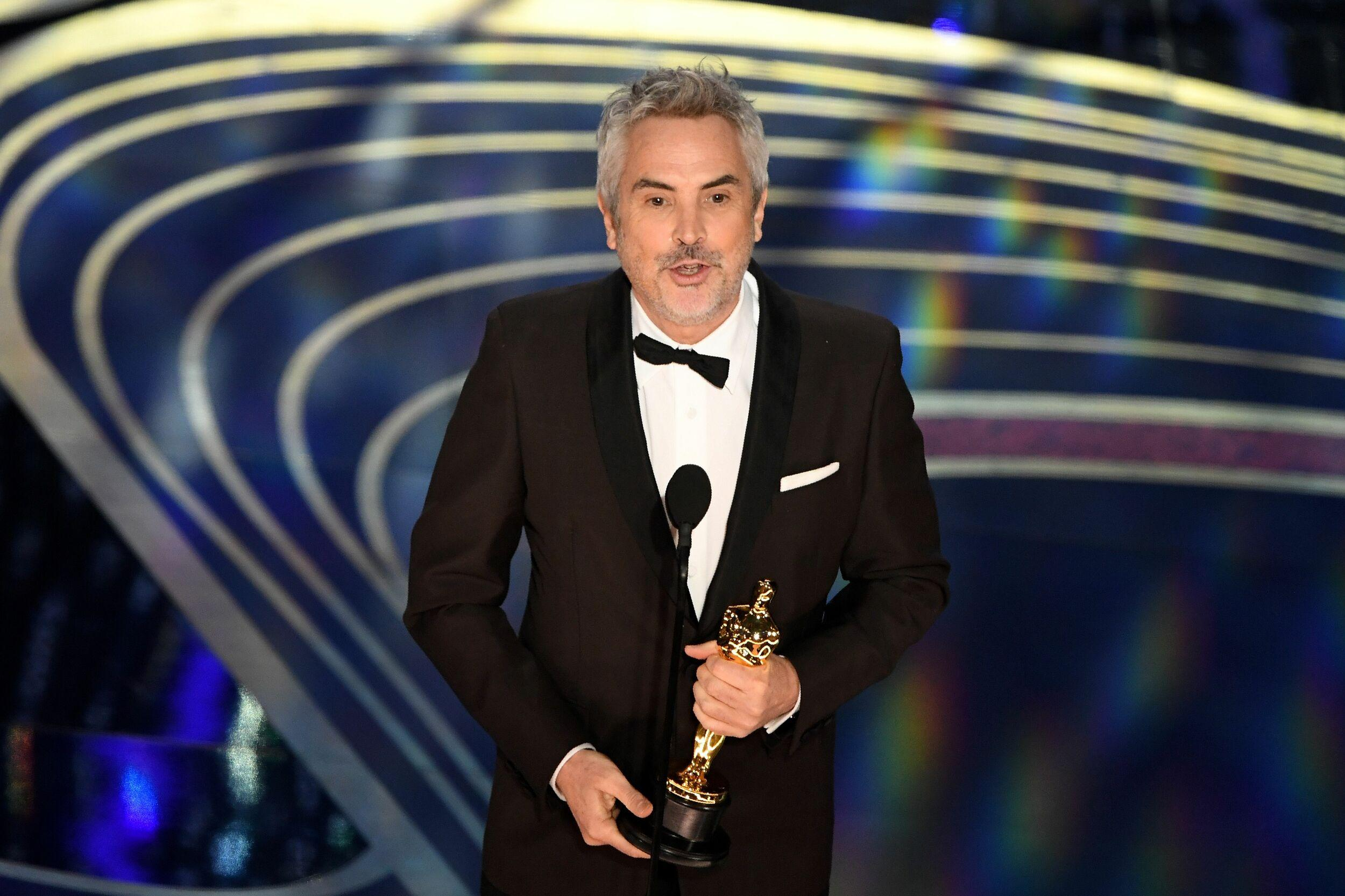 Best Cinematography nominee for 'Roma' Alfonso Cuaron accepts the award for Best Cinematography during the 91st Annual Academy Awards at the Dolby Theatre in Hollywood, California on February 24, 2019. (Photo by VALERIE MACON / AFP)        (Photo credit should read VALERIE MACON/AFP/Getty Images)