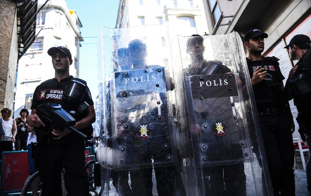 Turkish riot police officers block a road to prevent LGBT rights activists from going ahead with an annual Gay Pride parade. The Istanbul governor's office banned the parade citing safety and public order concerns. (AFP Photo/BULENT KILIC)