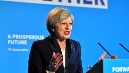 Theresa May announces 'dementia tax' U-turn after backlash