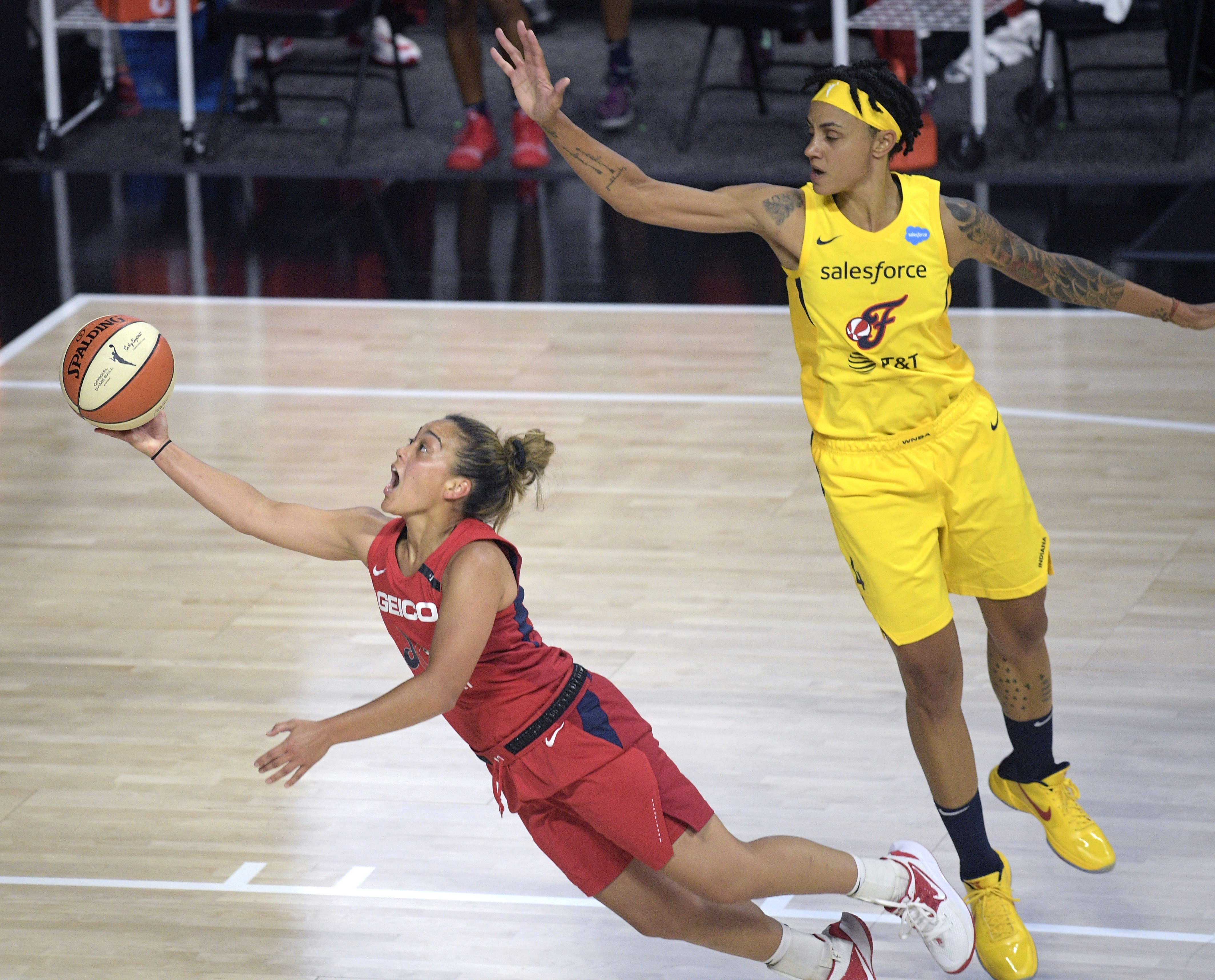 Washington Mystics guard Leilani Mitchell, left, makes a basket after being fouled by Indiana Fever forward Candice Dupree (4) during the first half of a WNBA basketball game, Saturday, July 25, 2020, in Ellenton, Fla. (AP Photo/Phelan M. Ebenhack)