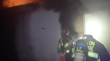 Florida Firefighters Rescue Woman Trapped in Burning Building