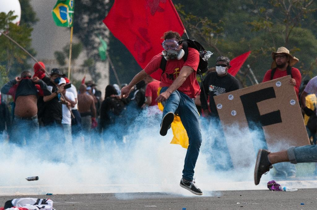 Clashes erupted between demonstrators and police almost as soon as the crowd got close to the government complex (AFP Photo/Andressa Anholete)