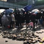 Officer Workers Don Face Masks to Support Protesters in Hong Kong's Central