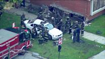 RAW: Car slams into home on 87th and Michigan