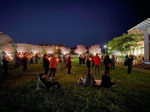 About 100 people gathered on the Herndon Town Green Sunday night to honor the memory of Ruth Bader Ginsburg.