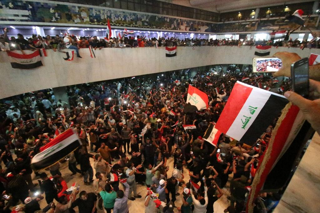 Anti-corruption protesters occupy the Iraqi parliament after breaking into Baghdad's fortified Green Zone compound on April 30, 2016 but more than 18 months on campaigners say graft still exists in every party (AFP Photo/HAIDAR MOHAMMED ALI)