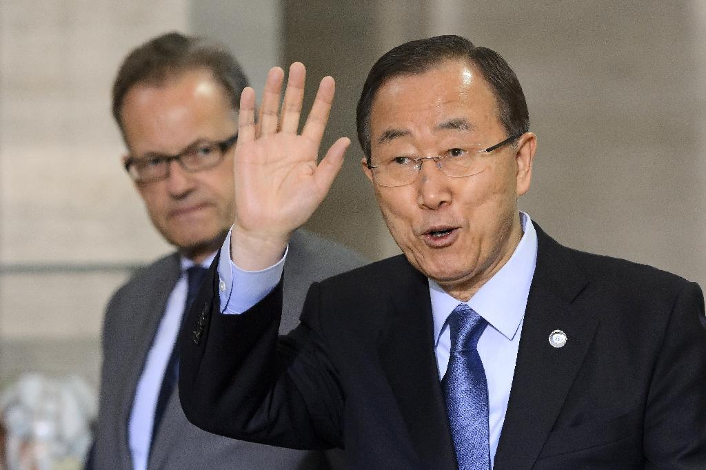 UN General Secretary Ban Ki-moon (R) gestures next to Acting Head of the United Nations (UN) Office at Geneva Michael Moller upon his arrival on June 14, 2015 at the UN offices in Geneva on the eve of Yemen peace talks (AFP Photo/Fabrice Coffrini)