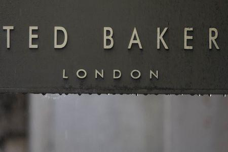f0b258fb402a Rain drips off a sign on a Ted Baker sign on a store in London