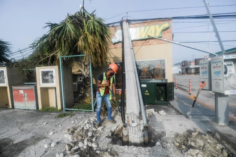 Hurricane Delta knocked down street lamps and uprooted trees when it hit Cancun on Mexico's Caribbean coastline