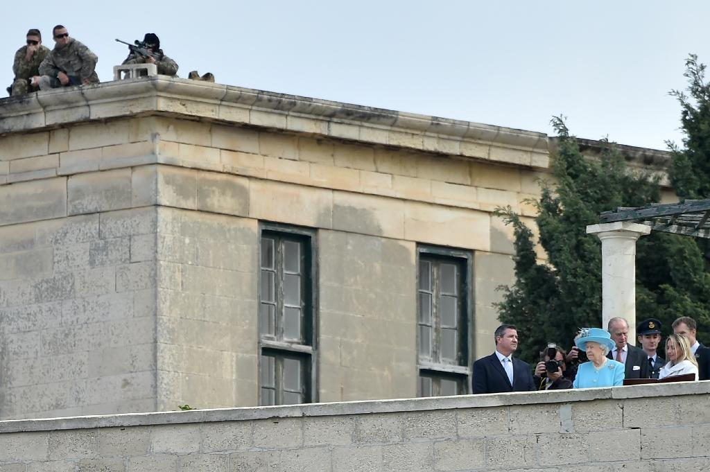 Snipers stand on a roof as Queen Elizabeth II and her husband Prince Philip visit the Heritage Malta centre on the sidelines of the Commonwealth Heads of Government Meeting (CHOGM) in Malta on November 28, 2015 (AFP Photo/Alberto Pizzoli)