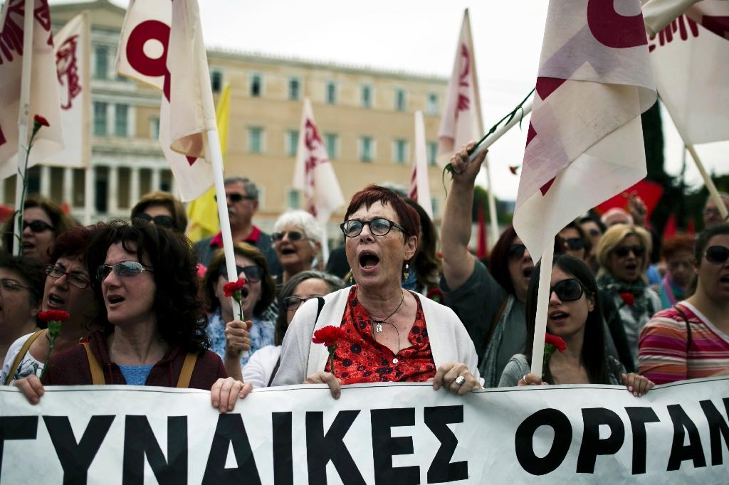 Members of the communist-affiliated PAME union take part in a rally in Athens on May 8, 2016 (AFP Photo/Aangelos Tzortzinis )