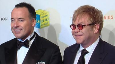 Elton John And David Furnish's 'Enduring' Fight Against AIDS