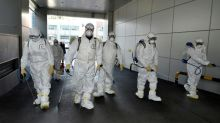 First South Korea virus patient dies as number of infections doubles