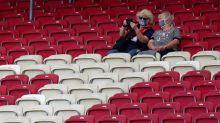 Bundesliga fans back in stadiums but tracking virus stats
