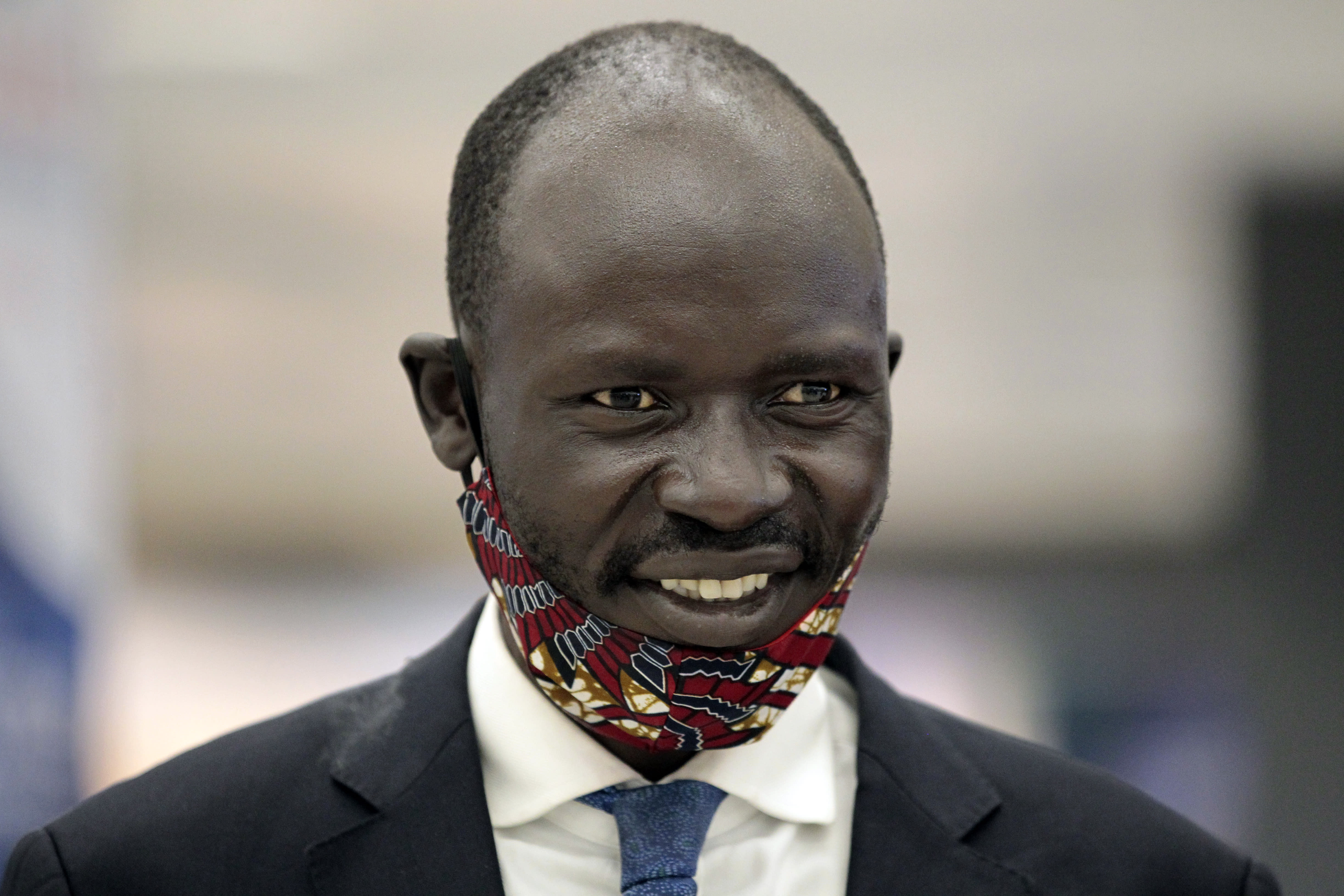 Peter Biar Ajak smiles before giving an interview upon his arrival at Washington Dulles International Airport in Chantilly, Va., Thursday, July 23, 2020. (AP Photo/Luis M. Alvarez)