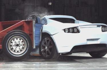 Tesla Roadster gets wrecked by the feds... in the name of safety, of course