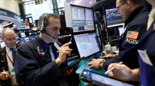Wall Street ends mixed as investors eye earnings