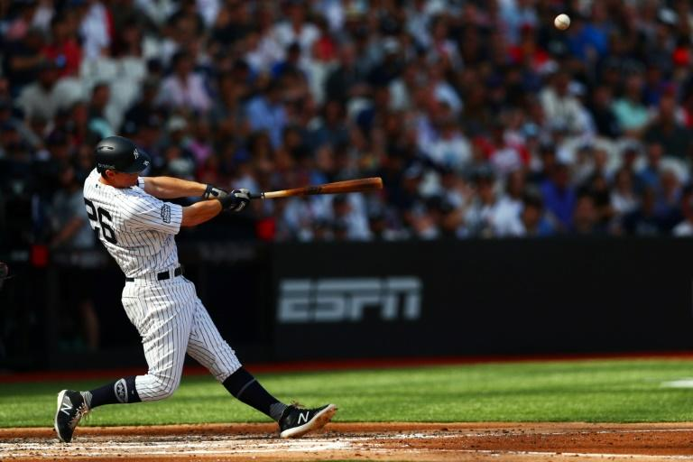 Yankees defeat Red Sox 12-8 to sweep