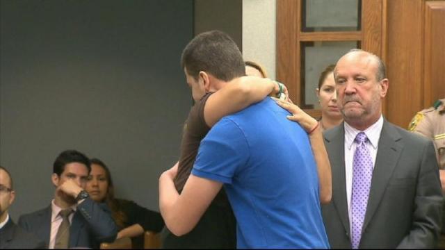 Mother Hugs Daughter's Killer in Court