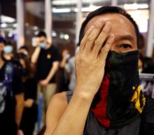 Hong Kong protest moves peacefully to mob-attack subway