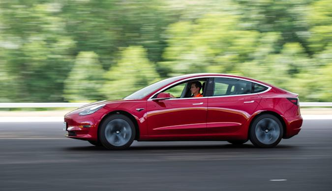 Joe Young, media relations associate for the Insurance Institute for Highway Safety (IIHS), drives a 2018 Tesla Model 3 at the IIHS-HLDI Vehicle Research Center in Ruckersville, Virginia, U.S., July 22, 2019.  Picture taken July 22, 2019. REUTERS/Amanda Voisard