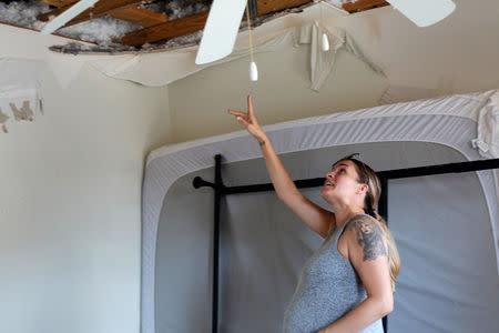 Jennifer Maher, pregnant in her third trimester, looks over damage to her home post-Hurricane Florence at Marine Corps Base Camp Lejeune, North Carolina, U.S., September 27, 2018. REUTERS/Andrea Januta