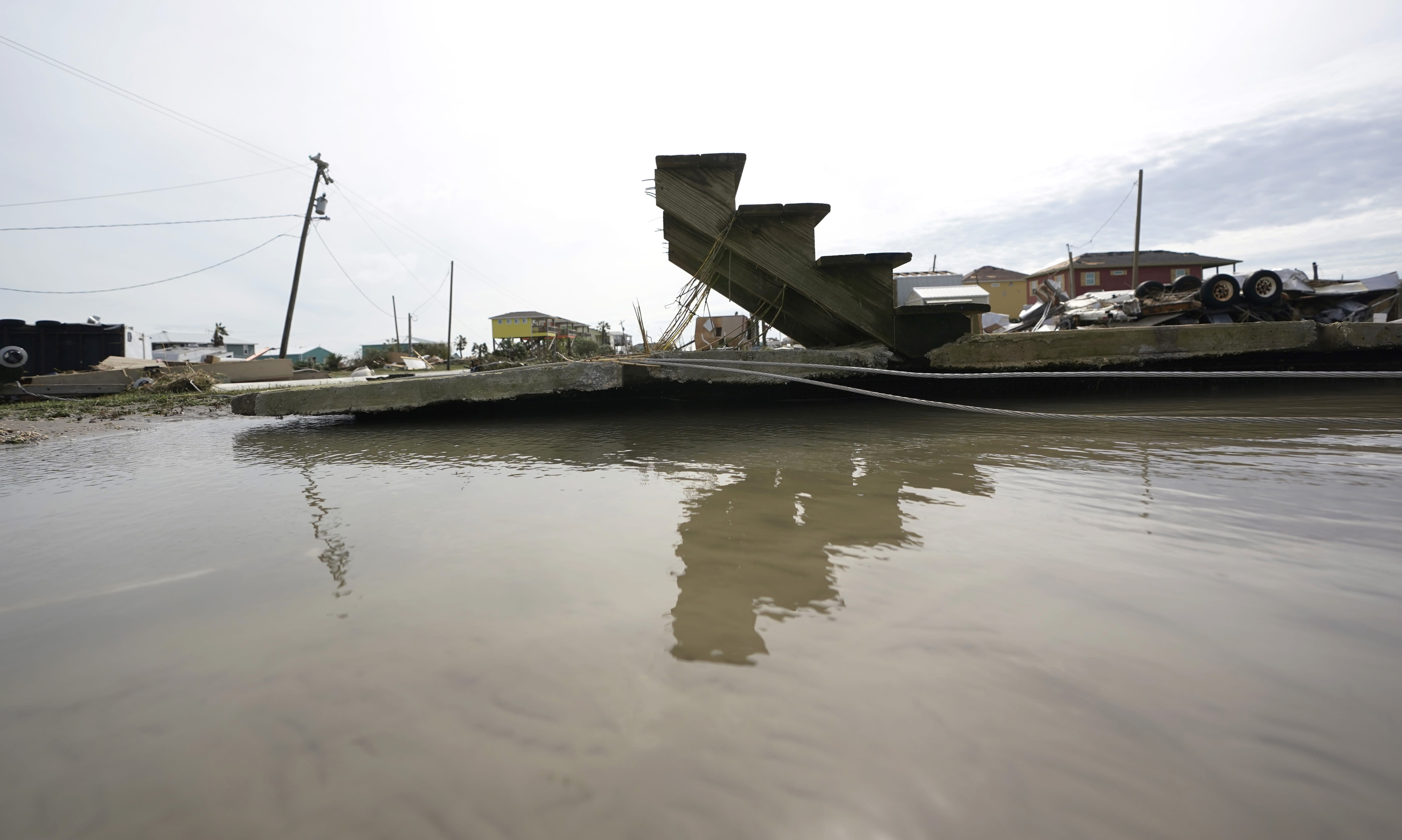 Stair steps and a slab are left behind in the wake of Hurricane Laura, Thursday, Aug. 27, 2020, in Holly Beach, La. (AP Photo/Eric Gay)