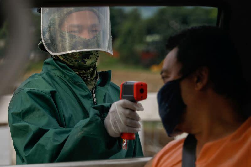 Philippine capital back on strict lockdown amid coronavirus infections spike