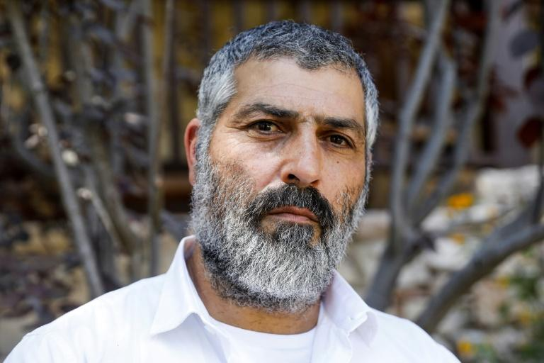 Tzvi Yehezkeli, Israeli television journalist and documentary filmmaker, poses for a picture at his home in an Israeli settlement in the occupied West Bank (AFP Photo/MENAHEM KAHANA)