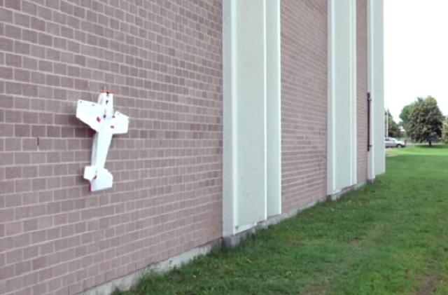 Fixed-wing drone lands on vertical surfaces like a bug