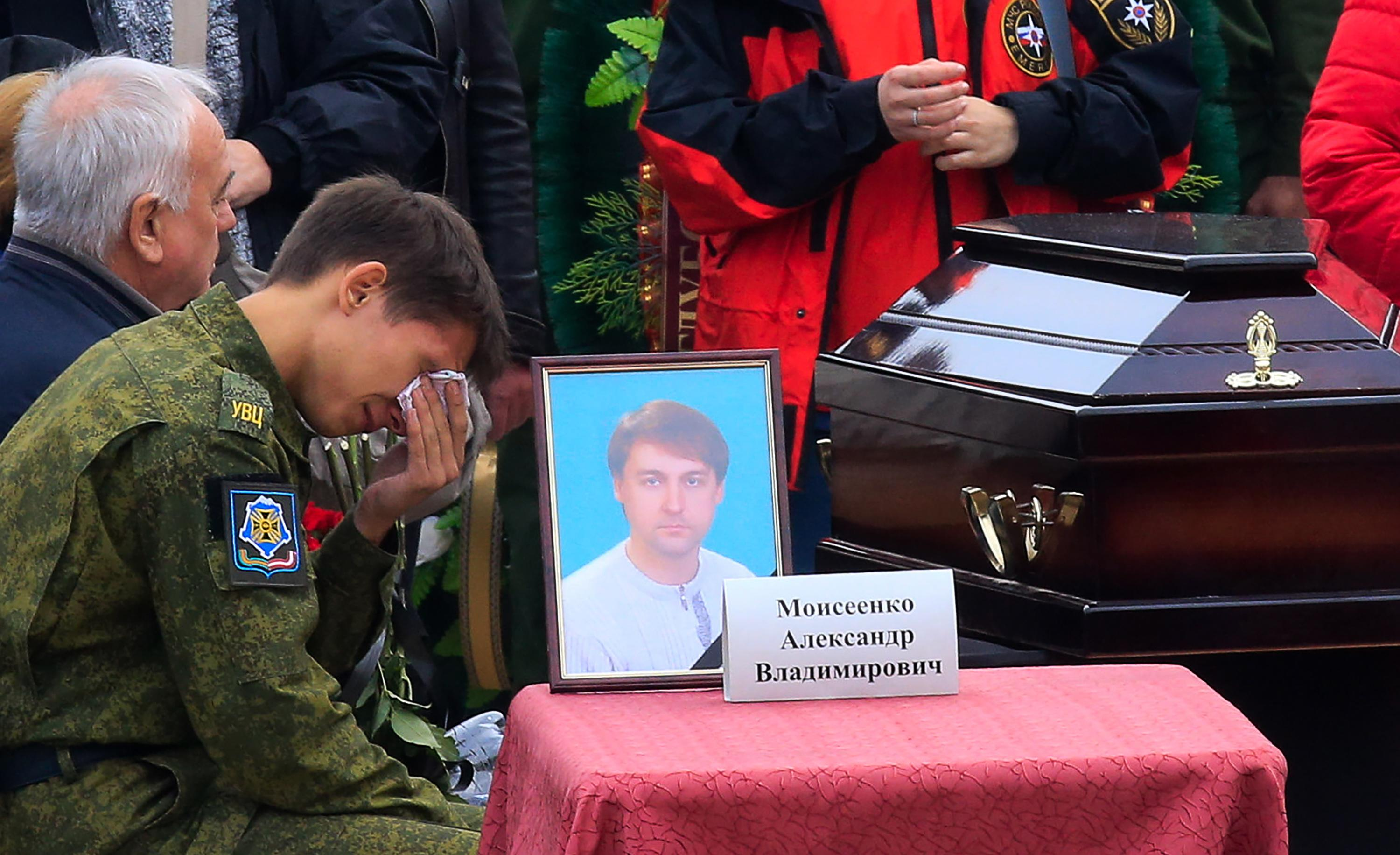 <p>Relatives of a Kerch school attack victim, teacher Alexander Moiseyenko, at a ceremony in Lenin Square on Oct. 19, 2018, to pay last respects to victims of the October 2018 explosion and shooting incident at the Kerch Polytechnic Vocational School in Kerch, Crimea. (Photo: Valery Matytsin/TASS via Getty Images) </p>