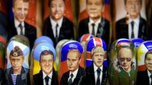On magnets, mugs and matryoshka dolls, Putin's face still sells