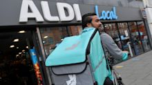 COVID helps Deliveroo turn a profit as orders and customers surge
