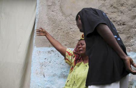A woman mourns after her son was killed during gunfire in the Nyakabiga neighbourhood of Burundi's capital Bujumbura, December 12, 2015. REUTERS/Jean Pierre Aime Harerimana