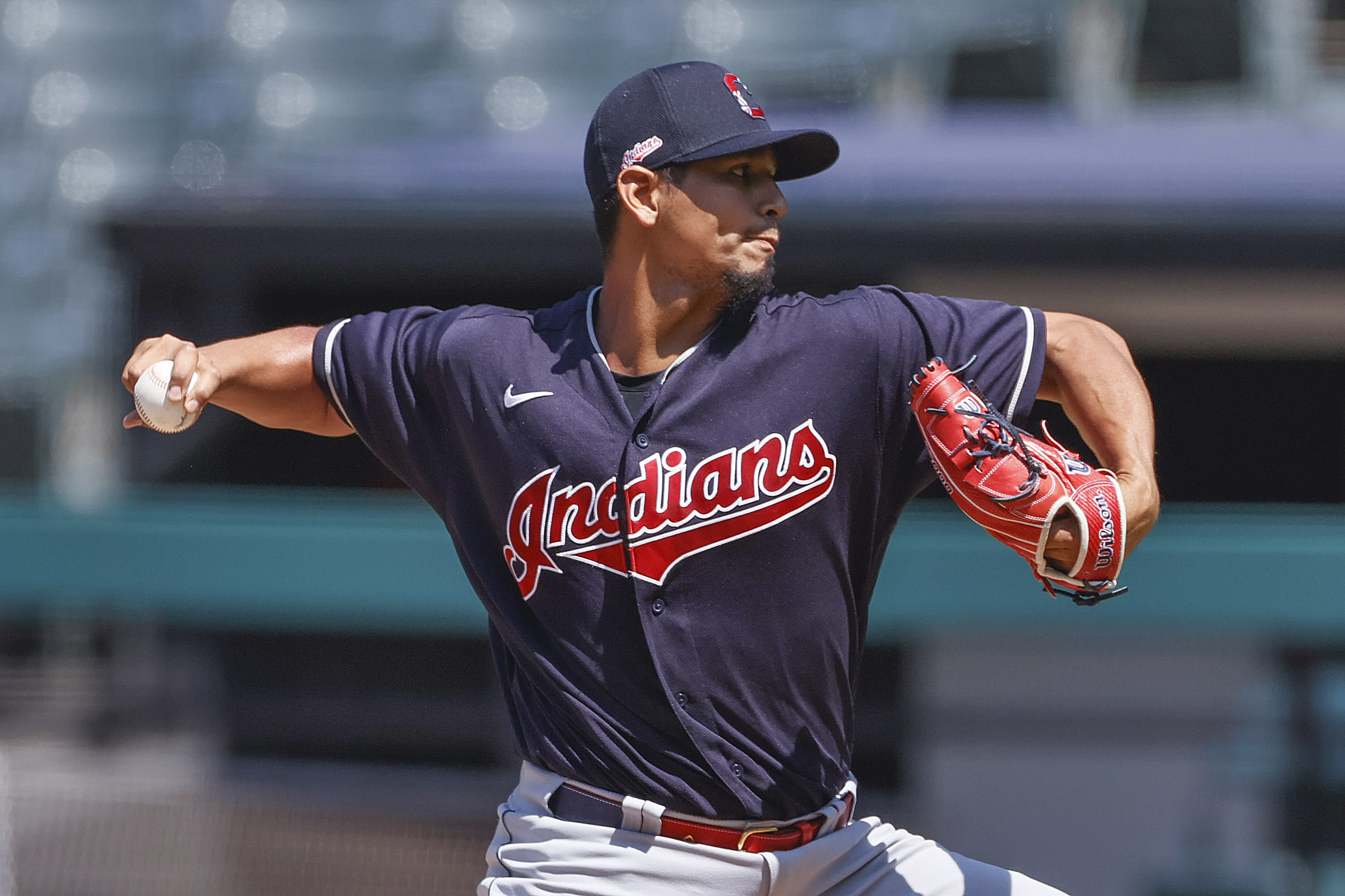 Cleveland Indians starting pitcher Carlos Carrasco delivers during baseball practice, Monday, July 6, 2020, in Cleveland. (AP Photo/Ron Schwane)