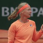 The Latest: Bertens leaves court in wheelchair after win