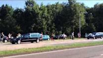 Hearses Transport Forty Coffins of MH17 Victims to Hilversum