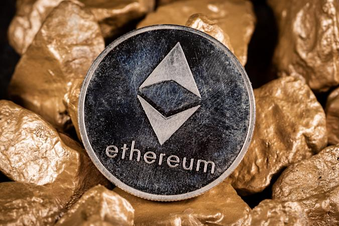 Ethereum cryptocurrency with gold nuggets. Investment and store of value concept. SLOVENIA, LJUBLJANA: 12 April 2021