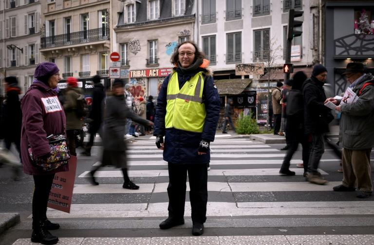 Serge, a 59-year-old postman says a lot of postal workers are now on short-term contracts (AFP Photo/Lionel BONAVENTURE)